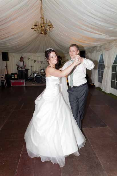 Bride and groom ballroom dancing