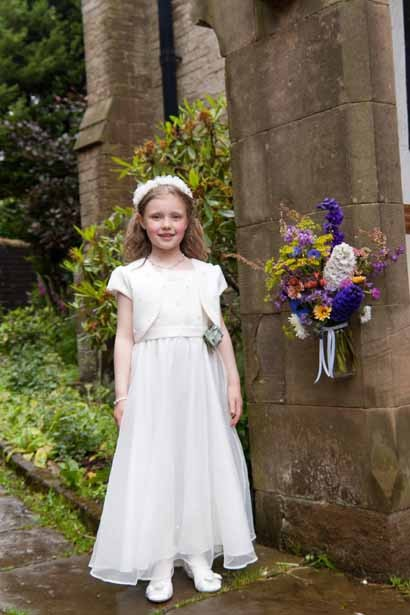 Flower girl outside church