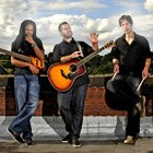 The Roots Acoustic Trio are available in Anglesey